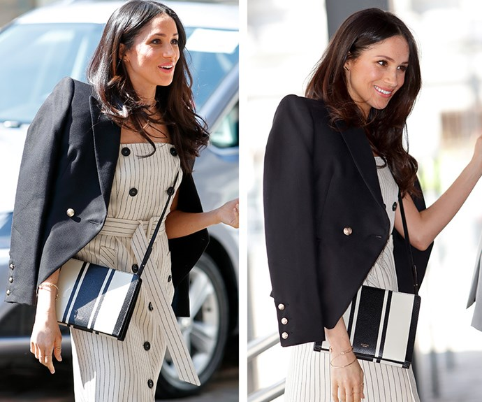 The 36-year-old looked the picture of royal sophistication as she, with her fiance Prince Harry, met with delegates of the Commonwealth Youth Forum wearing a black and white striped dress by New York-based brand Altuzarra, a black blazer by Australian designer Camilla and Marc and a stripped cross-body bag from Aussie fashion stalwart Oroton.