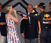 Bottoms up! Princess Charlene downs champagne at the Monaco Grand Prix