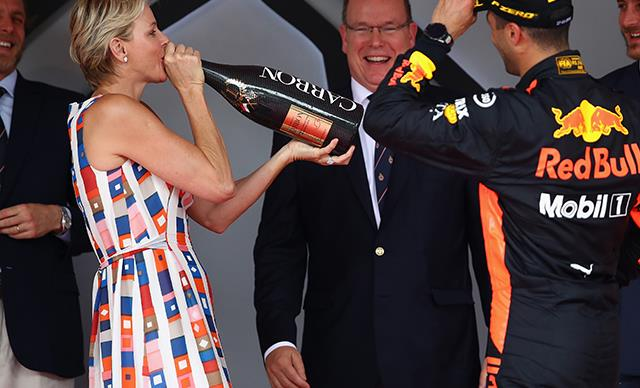 Bottoms up! Princess Charlene downs champagne at the Monaco Grand Prix