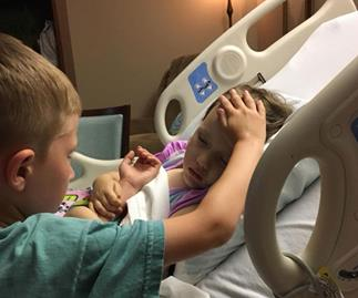 Photo of a brother saying goodbye to his sister as she dies of cancer is too heartbreaking for words
