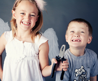 Young boy and girl pulling out teeth for a tooth fairy visit