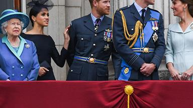 She's in the top spot! Meghan Markle stands next to The Queen at Buckingham Palace