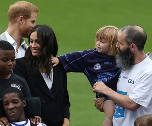 Cheeky toddler pulls Meghan Markle's hair and Prince Harry can't stop laughing