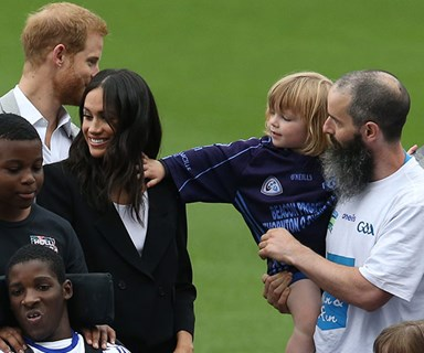 A cheeky toddler pulls Meghan Markle's hair and Prince Harry can't stop laughing