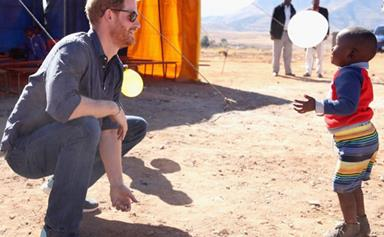 The royal family has released new photos of Prince Harry's trip to Africa