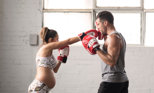 Sam Wood and Snezana Markoski demonstrate exercise after birth