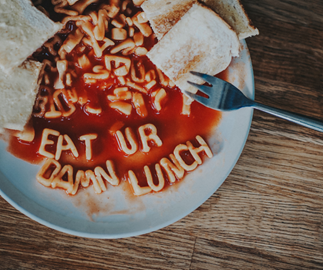 Plate of spaghetti alphabet spelling out eat Your Damn Lunch