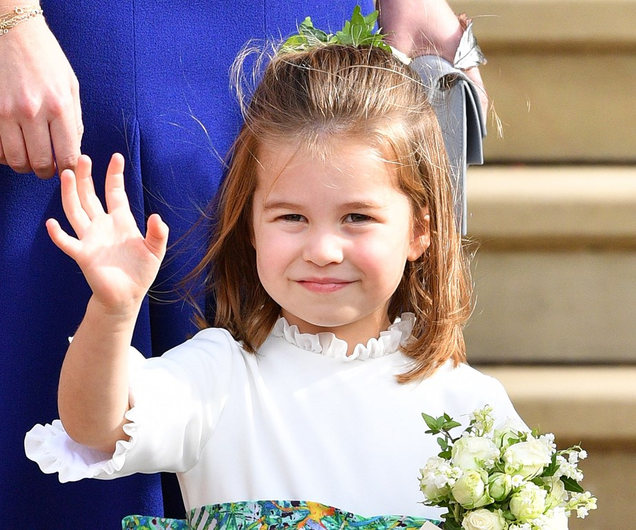 "This photo of Princess Charlotte as a bridesmaid at Princess Eugenie's wedding had [people drawing comparisons](https://www.nowtolove.co.nz/celebrity/royals/princess-charlotte-prince-william-photo-everyone-talking-about-39473|target=""_blank"") to Prince William and her grandmother the late Princess Diana, because of her 'Diana smirk'. *(Image: Getty)*"