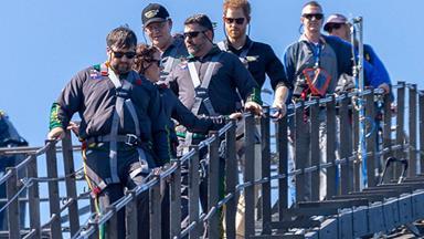 Prince Harry raises the Invictus Games flag on the Harbour Bridge