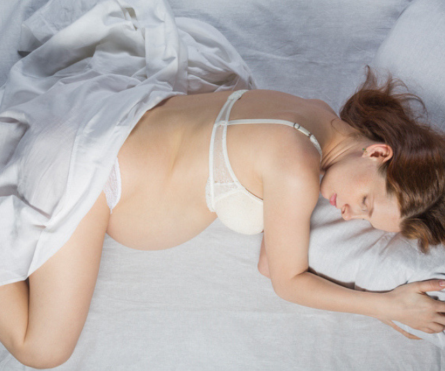 Is it safe to lay on your stomach while you're pregnant?