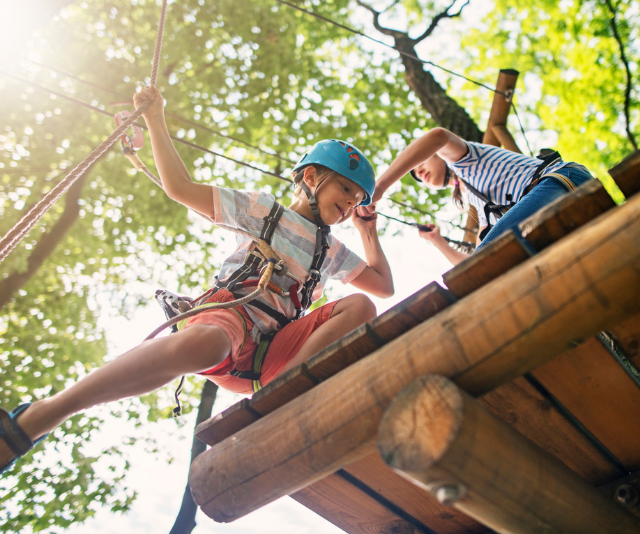 School camp checklist. Children on high ropes course.