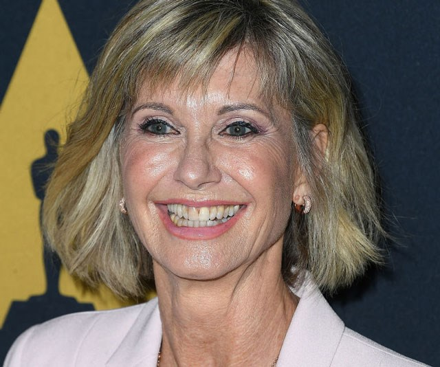 Olivia Newton John is  'clinging on to life', say close sources