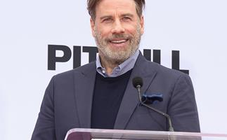 John Travolta revealed his bald head to the world and the Internet is loving it