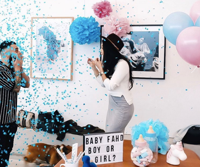 It's a boy! The couple announced the happy news with this sweet snap.