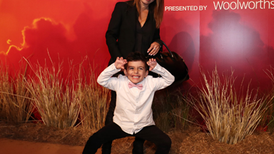 EXCLUSIVE: Watch the moment Ada Nicodemou's son Johnas steals the spotlight at The Lion King premiere