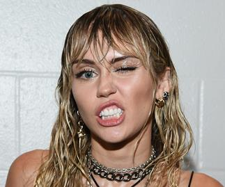 We just got a close-up look at Miley Cyrus' new breakup tattoo