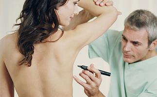 So you're considering a boob job? Here's what to consider before going under the knife
