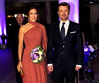 Prince Frederik looks absolutely smitten with Princess Mary as she glows in stunning evening gown
