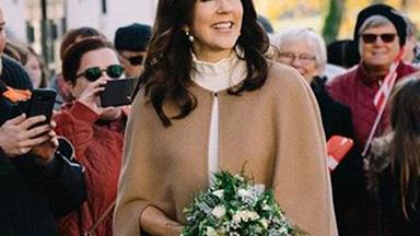Crown Princess Mary glows as she steps out in the beige coat of our dreams