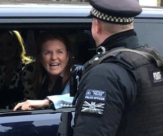 Sarah Ferguson is all smiles as she heads to Buckingham Palace for crisis talks