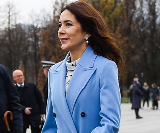 Crown Princess Mary wears a trench coat with a colourful twist as she steps out in Poland