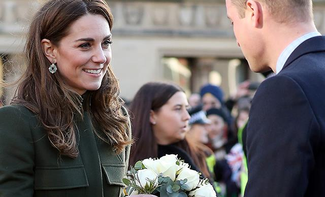 Wills gives flowers to Kate in rare PDA moment during their first joint engagement for the year