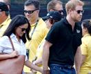 Meghan and Harry threaten legal action days after arriving in Canada as paparazzi swarm