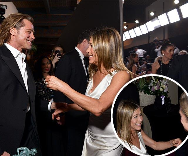 The photographer behind Brad and Jen's viral reunion at the SAGs speaks up about what really went down