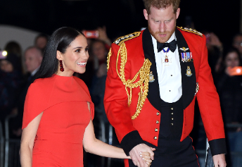Meghan & Harry opt for matching siren red ensembles as they arrive at musical date night in London