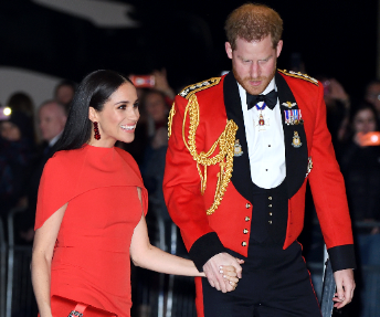 Meghan & Harry opt for matching siren-red ensembles as they arrive at musical date night in London