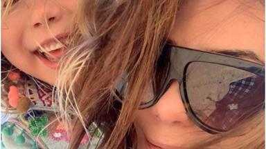 Kate Ritchie documents special beach day out with her six-year-old daughter Mae in rare new photo