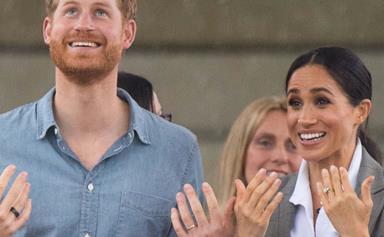 Prince Harry & Duchess Meghan have chosen one of their most iconic photos from Australia to share with fans
