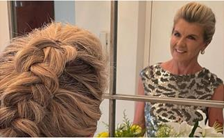 Julie Bishop reveals how long her has grown as she wears it loose in a 60s-style 'do in new picture
