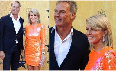 Julie Bishop makes a zesty statement in a bright orange dress at the Hamilton premiere in Sydney