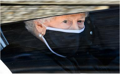 The Queen pays tribute to her late husband Prince Philip in a striking black outfit at his funeral