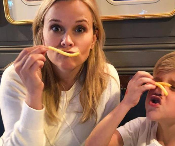 Reece Witerspoon eating fries with son