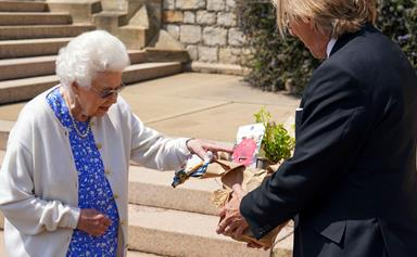 The Queen is pictured receiving a special and emotional gift to mark what would have been Prince Philip's 100th birthday