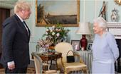 Harry, Meghan, William and Kate stand side-by-side taking pride of place on The Queen's mantelpiece