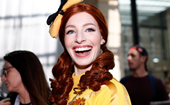 Yellow Wiggle Emma Watkins shows off a dramatic blonde look as the iconic Iris Apfel