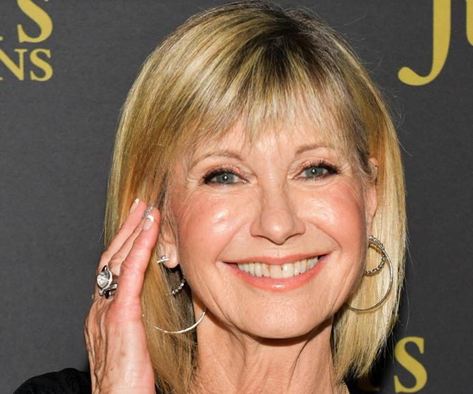 Olivia Newton-John gets her groove on as she reacts to a TikTok dance routine to her song Physical, but does the icon approve?