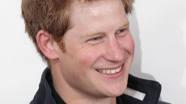 Prince Harry dives into pool fully clothed