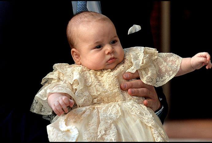 Prince George wearing a replica of the royal christening gown.