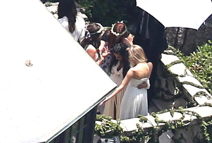 Kim embraces friends as she mingles with guests at her shower.