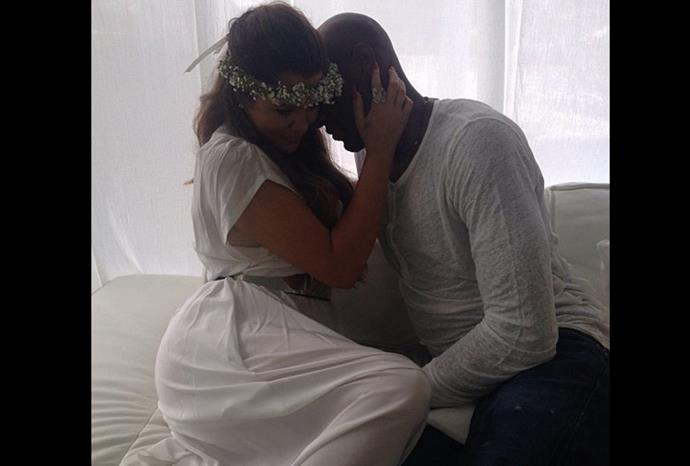 Khloe and Lamar embrace on the couch.