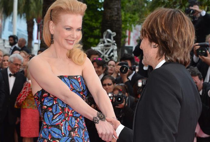 Nicole leads Keith down the red carpet.
