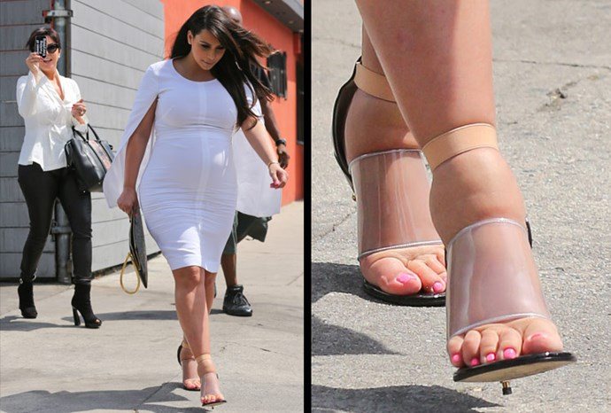 Kim Kardashian steps out with extremely swollen feet.