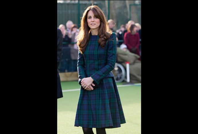 Kate wears a dress with a full flowing skirt.