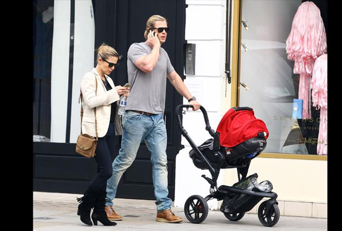 Chris and Elsa take a stroll with baby India in London.