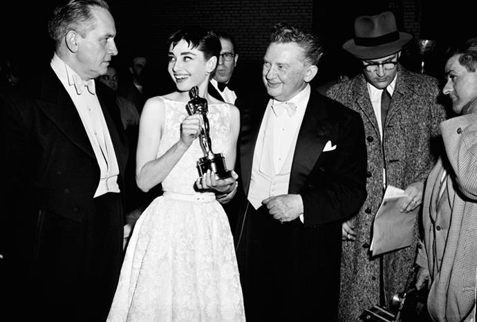 In 1954 Audry Hepburn accepted her Best Actress Oscar in a white floral Givenchy gown.