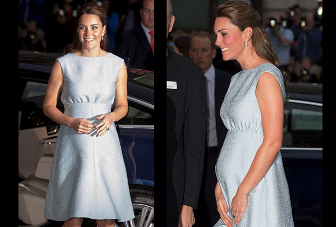 Catherine in a simple, elegant light blue dress.